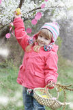 Pretty girl holding painted egg outdoor Stock Images