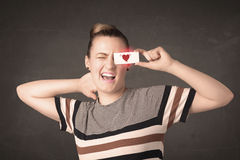 Pretty girl holding paper with red heart drawing Royalty Free Stock Photo