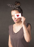 Pretty girl holding paper with red heart drawing Royalty Free Stock Images