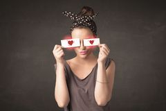 Pretty girl holding paper with red heart drawing royalty free stock image