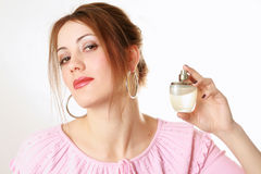 Pretty girl holding perfume Stock Photos