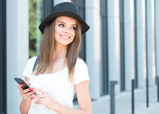 Pretty Girl Holding Phone Outside the Building Stock Image