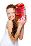 Pretty girl holding present close her head Stock Photography