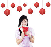 Pretty girl holding red packet gift Royalty Free Stock Image