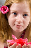 Pretty girl holding rose petals Stock Photos