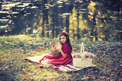 Pretty girl holding small basket Royalty Free Stock Photos