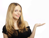 Pretty girl holding something imaginary Stock Images