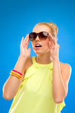 Pretty girl holding sunglasses. Royalty Free Stock Photos
