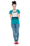 Pretty girl holding tablet pc Royalty Free Stock Images
