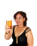 Pretty girl holding up glass of tee. Stock Photography