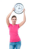 Pretty girl holding the wall clock Royalty Free Stock Photography