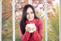 Pretty girl holding warm drink Stock Photos