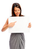 Pretty girl holding a white board Stock Photography