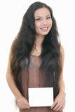 Pretty girl holding white card Royalty Free Stock Photography