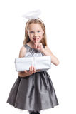 Pretty girl holding a wrapped Christmas gift Royalty Free Stock Photos