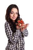 Pretty girl holding a wrapped gift Royalty Free Stock Photos