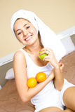 Pretty girl at home with fruit Stock Photos