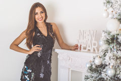Pretty girl at home with letters new year Stock Image