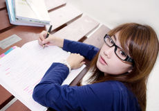 Pretty girl and homework. Asian pretty girl make her homework Stock Photo