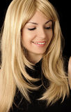 Pretty girl with honey blond hair Royalty Free Stock Photos