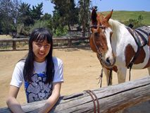 Pretty Girl With Horse 2. Pretty girl standing next to her horse Stock Photo