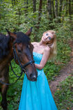 Pretty girl and a horse Stock Image