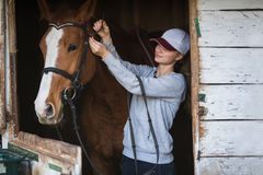 Pretty girl with horse Stock Image