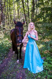 Pretty girl and a horse Royalty Free Stock Images