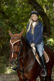 Pretty girl horseback riding Stock Photos