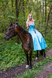 Pretty girl on horseback Royalty Free Stock Image