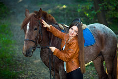 Pretty girl with horses Royalty Free Stock Photography