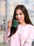 Pretty girl with hot coffee. Stock Photography