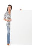 Pretty girl with huge blank sheet Royalty Free Stock Photography