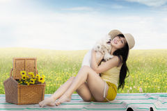 Pretty girl hugging a dog at field Royalty Free Stock Photo