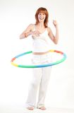 Pretty girl with hula hoop Stock Photos