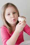 The pretty girl with ice cream. Theindoor portrait of a beautiful girl with ice cream stock photography
