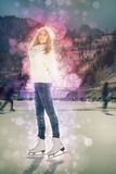 Pretty girl ice skating outdoor at ice rink Stock Images