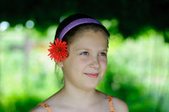 Pretty girl. An image of a girl with a flower in her hair royalty free stock image