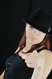 Pretty Girl In Black Hat Show On You Royalty Free Stock Images
