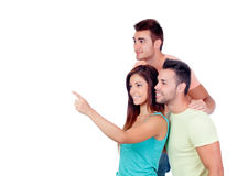 Pretty girl indicating something with two handsome boys Royalty Free Stock Photos