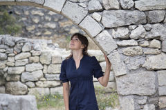 Pretty girl inspecting the fortress ruins Royalty Free Stock Image