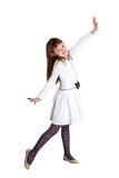 Pretty girl isolated. Pretty little girl wearing white dress standing on white background Stock Photo