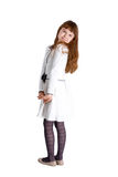 Pretty girl isolated. Pretty little girl wearing white dress standing on white background Royalty Free Stock Photo