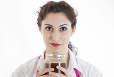 Pretty girl with a jar of honey Stock Photography