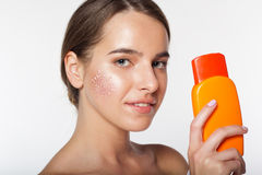 Pretty girl with jar of sun protection lotion Stock Photo