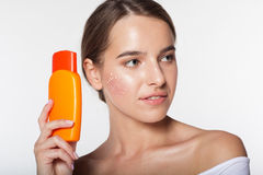 Pretty girl with jar of sunscreen lotion Royalty Free Stock Photography