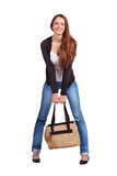 Pretty girl in jeans and a bag Stock Images