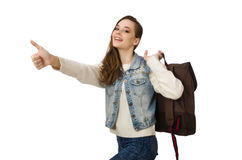 The pretty girl in jeans holding rucksack isolated on white Royalty Free Stock Photos