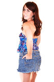 Pretty girl in jeans mini skirt. A lovely young girl in an jeans mini skirt and blue blouse with her red hair Royalty Free Stock Photo