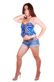Pretty girl in jeans mini skirt. A lovely young girl in an jeans mini skirt and blue blouse with her red hair Royalty Free Stock Images